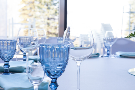 Glasses on the wedding table on a light background