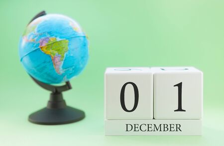 Planner wooden cube with numbers, 1 day of the month of December, winter