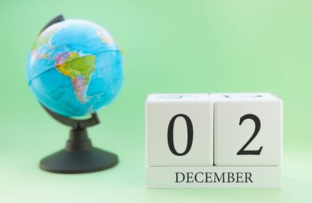Planner wooden cube with numbers, 2 day of the month of December, winter