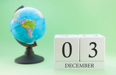 Planner wooden cube with numbers, 3 day of the month of December, winter