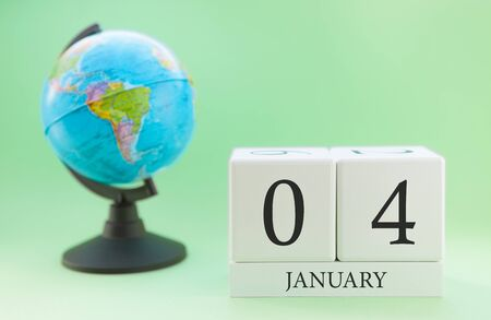 Planner wooden cube with numbers, 4 day of the month of January, winter Archivio Fotografico