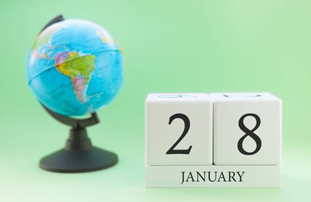 Planner wooden cube with numbers, 28 day of the month of January, winter