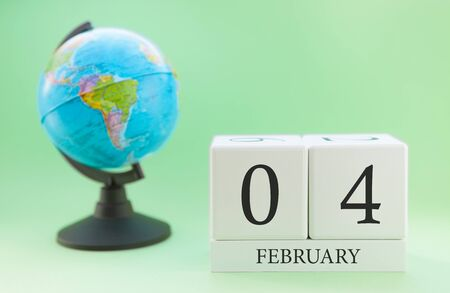 Planner wooden cube with numbers, 4 day of the month of February, winter