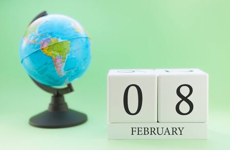 Planner wooden cube with numbers, 8 day of the month of February, winter Archivio Fotografico