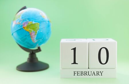 Planner wooden cube with numbers, 10 day of the month of February, winter