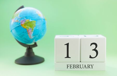 Planner wooden cube with numbers, 13 day of the month of February, winter Archivio Fotografico