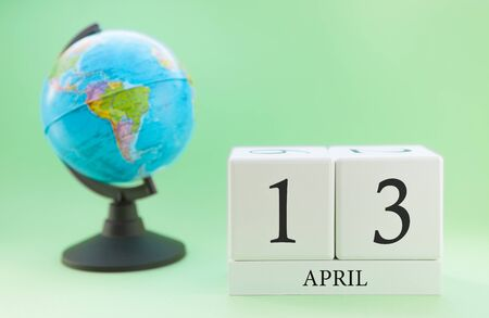 Planner wooden cube with numbers, 13 day of the month of April, spring