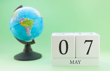 Planner wooden cube with numbers, 7 day of the month of May, spring