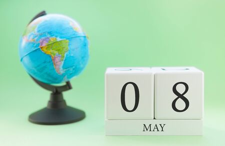 Planner wooden cube with numbers, 8 day of the month of May, spring