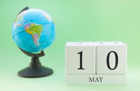 Planner wooden cube with numbers, 10 day of the month of May, spring Stock Photo