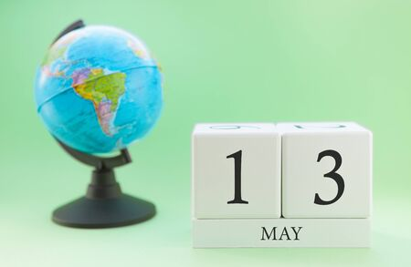 Planner wooden cube with numbers, 13 day of the month of May, spring