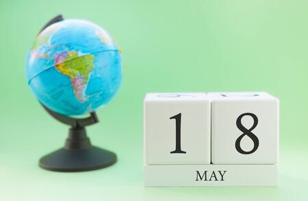 Planner wooden cube with numbers, 18 day of the month of May, spring Stock Photo