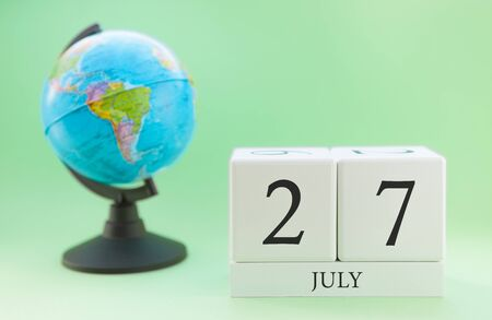 Planner wooden cube with numbers, 27 day of the month of July, summer