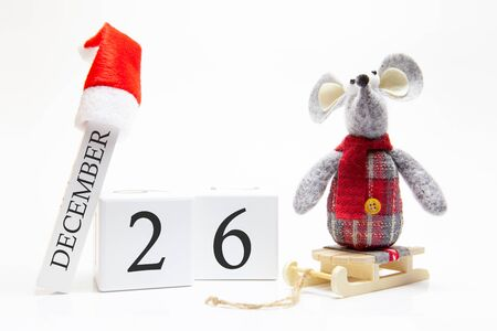 Wooden calendar with number December 26. Happy New Year! Symbol of New Year 2020 - white or metal (silver) rat. Christmas decorated. Stock Photo