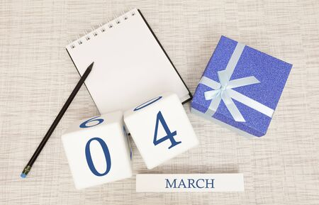 Calendar with trendy blue text and numbers for March 4 and a gift in a box.