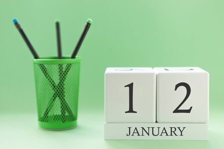 Desk calendar of two cubes for January 12