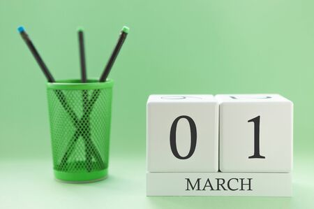 Desk calendar of two cubes for March 1