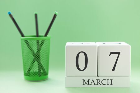 Desk calendar of two cubes for March 7