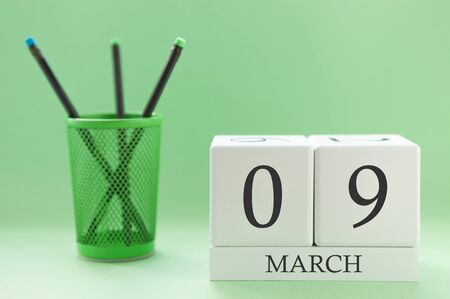 Desk calendar of two cubes for March 9