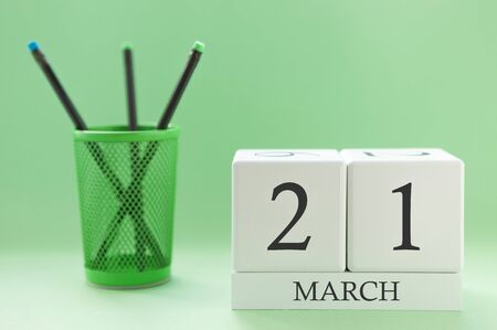 Desk calendar of two cubes for March 21