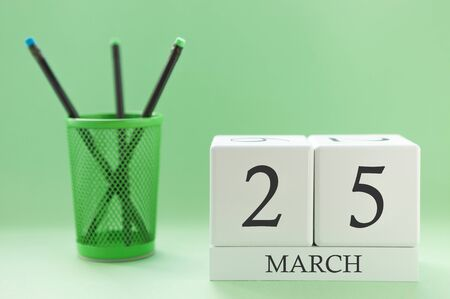 Desk calendar of two cubes for March 25