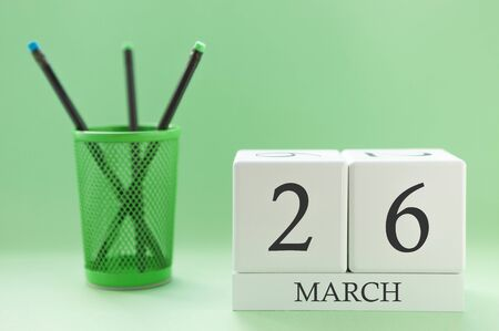 Desk calendar of two cubes for March 26