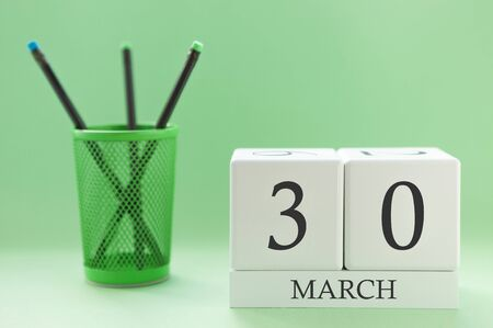 Desk calendar of two cubes for March 30