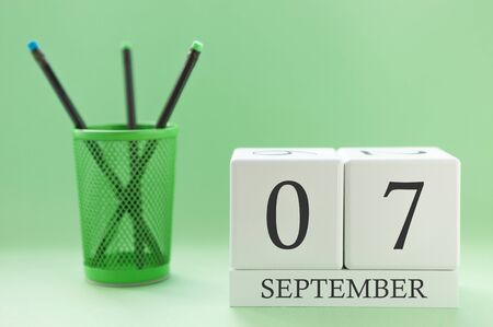 Desk calendar of two cubes for September 7