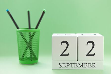 Desk calendar of two cubes for September 22 Stock Photo
