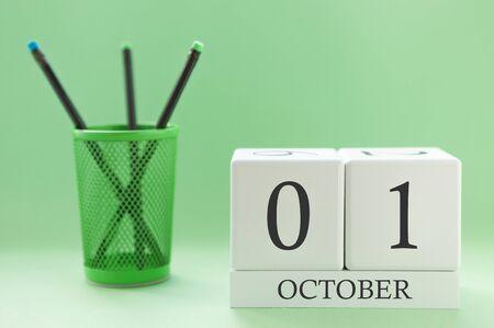 Desk calendar of two cubes for October 1 Banco de Imagens