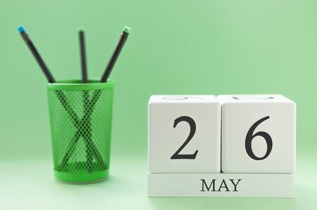 Desk calendar of two cubes for May 26