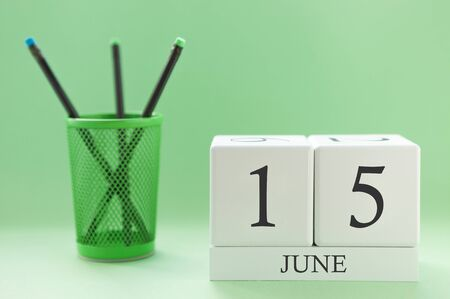 Desk calendar of two cubes for June 15