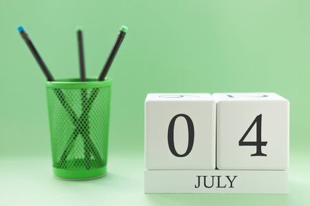 Desk calendar of two cubes for July 4