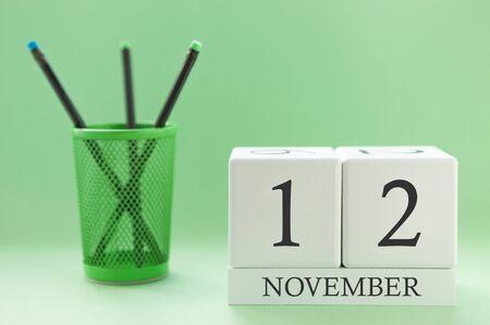 Desk calendar of two cubes for November 12
