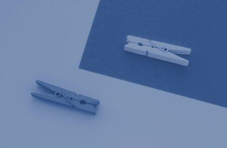 Blue and yellow clothespins on the background, toned trendy classic blue color of year 2020 版權商用圖片