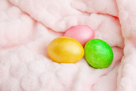 Beautiful colorful easter eggs. Easter concept on a soft plaid