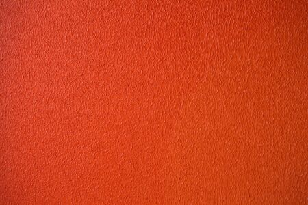 Orange or red plaster wall texture detailed close-up