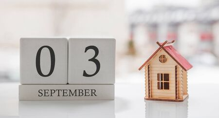 September calendar and toy home. Day 3 of month. Card message for print or remember