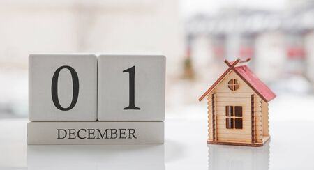 December calendar and toy home. Day 1 of month. Card message for print or remember Stock Photo