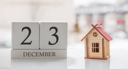 December calendar and toy home. Day 23 of month. Card message for print or remember