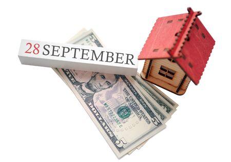 金钱,家庭和日历。金融独立概念和9月28日的预定开始日期