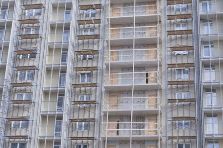 New building in an elite area of the city, construction site. Close-up on the balconies.