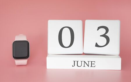 Modern Watch with cube calendar and date 03 june on pink background. Concept summer time vacation.