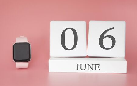 Modern Watch with cube calendar and date 06 june on pink background. Concept summer time vacation.