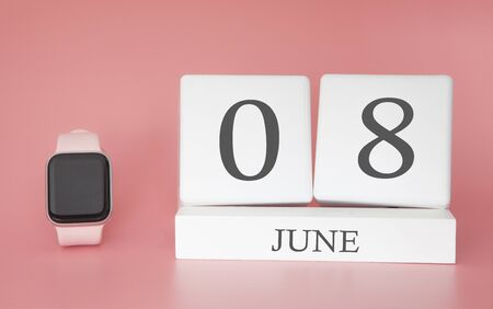 Modern Watch with cube calendar and date 08 june on pink background. Concept summer time vacation.