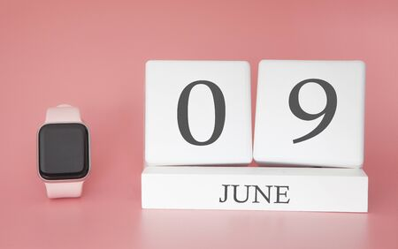 Modern Watch with cube calendar and date 09 june on pink background. Concept summer time vacation.
