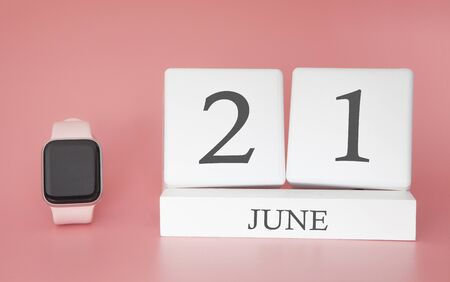 Modern Watch with cube calendar and date 21 june on pink background. Concept summer time vacation.