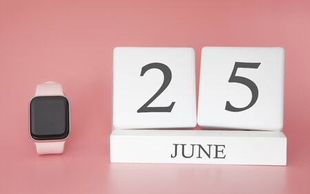 Modern Watch with cube calendar and date 25 june on pink background. Concept summer time vacation.