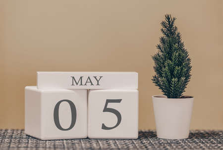 Desk calendar for use in different ideas. Spring month - May and the number on the cubes 05. Calendar of holidays on a beige solid background.