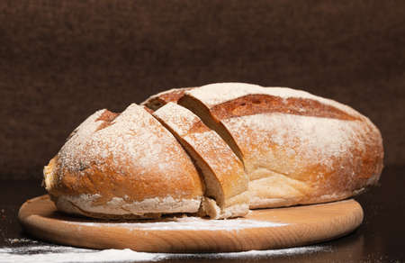 Fresh and tasty bread on a wooden board. Bakery products.